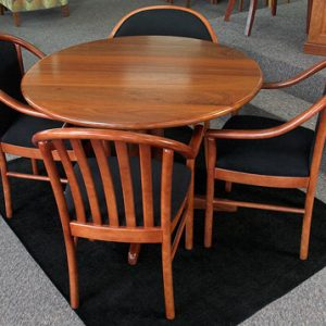 Claw base round table in Jarrah